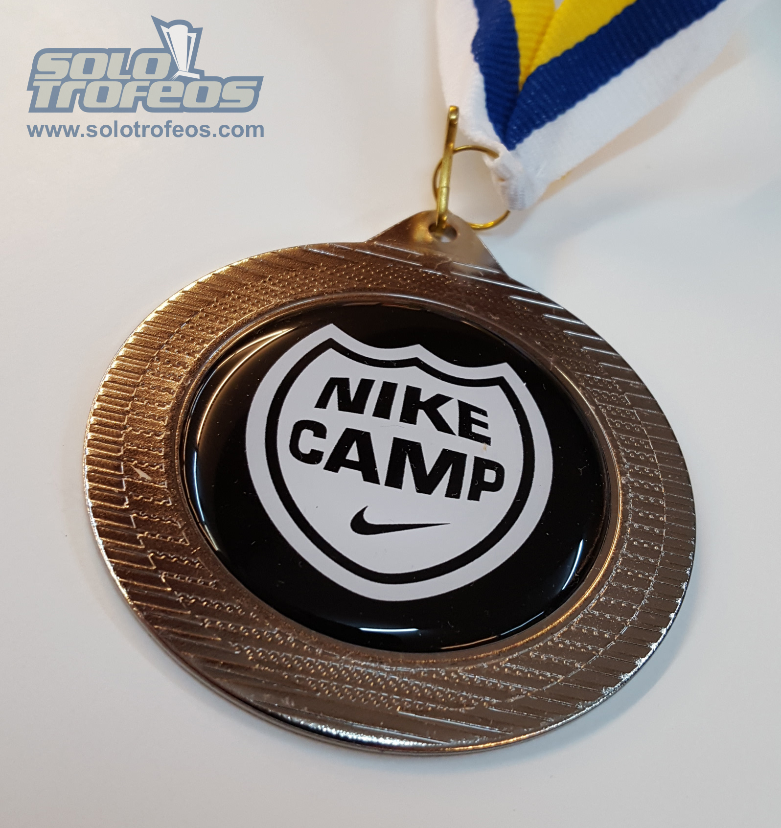 MEDALLA_NIKE CAMP